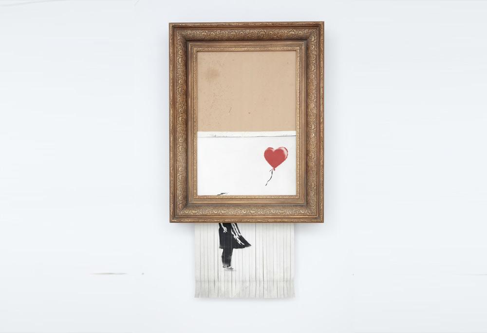 """Banksy, la compratrice dell'opera autodistrutta (che cambia nome) la terrà. E commenta: """"adesso ho il mio pezzo di storia dell'arte"""""""