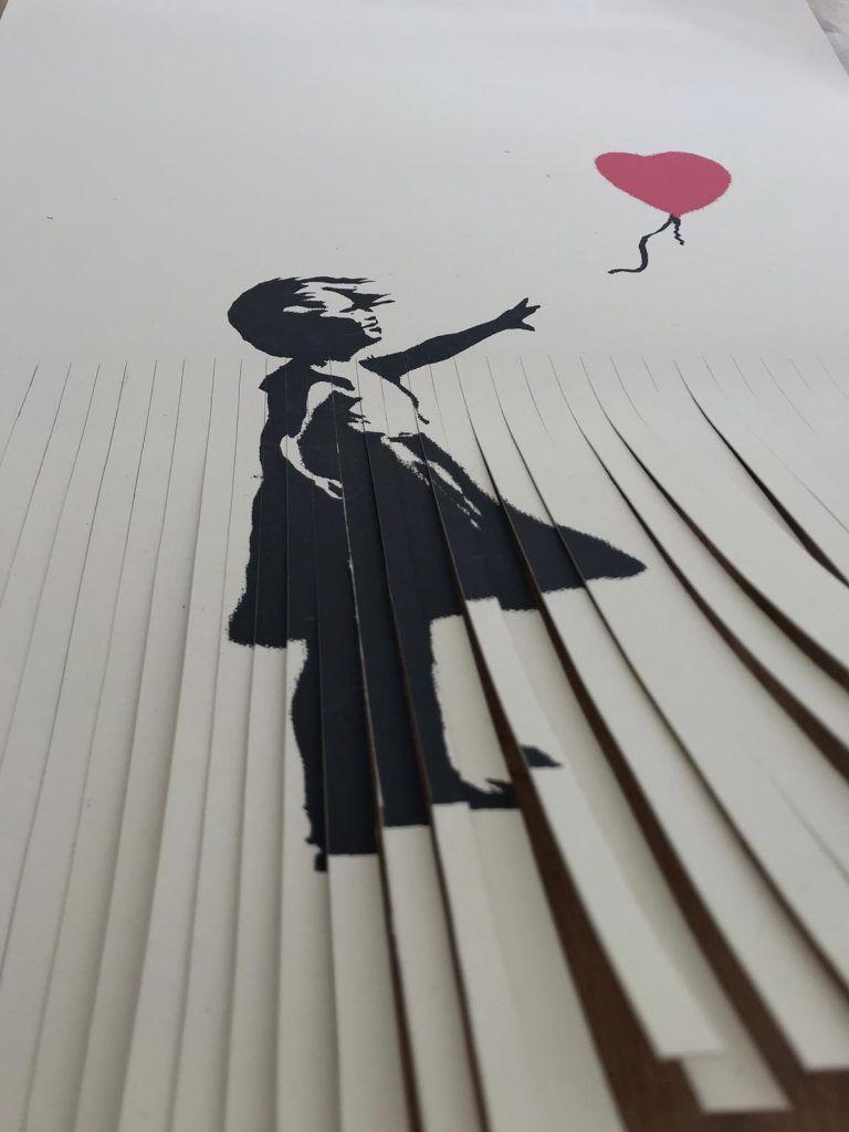Vuole imitare Banksy e sminuzza un originale da 40.000 sterline. Ora vale una sterlina
