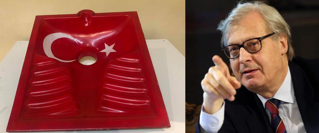 Minacce e insulti a Sgarbi per un'opera della sua mostra: un bagno alla turca con bandiera